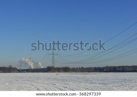 Electricity pylon with  power plant, power line, - stock photo