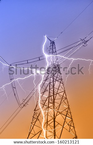 Electricity pylons and lines - stock photo
