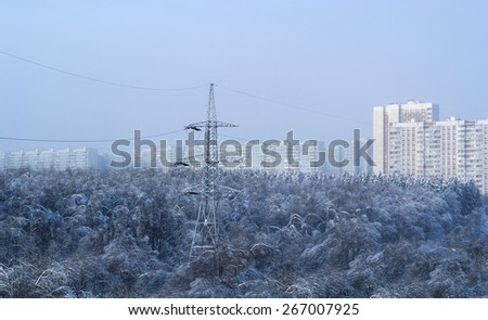 Electricity pylons and power high voltage power tower in winter evening