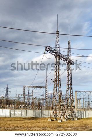 electricity pylons and power plant - stock photo