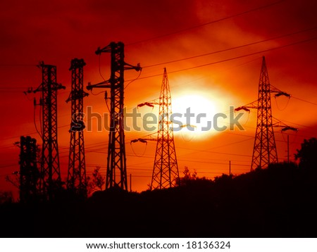 electricity pylons at the sunset - stock photo