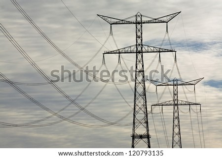 electricity pylons � high voltage power - stock photo
