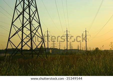 Electricity pylons in the field, base of pylon on the foreground #2 - stock photo