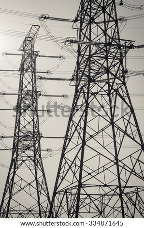 electricity pylons silhouette on the sky