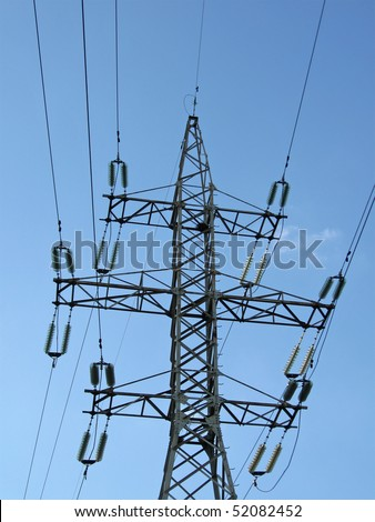 electricity pylons with electrical wires and blue sky. High voltage electrical power lines concept - stock photo