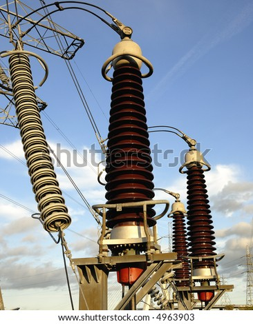 Electricity supply ceramic conductors connecting with the pylons - stock photo