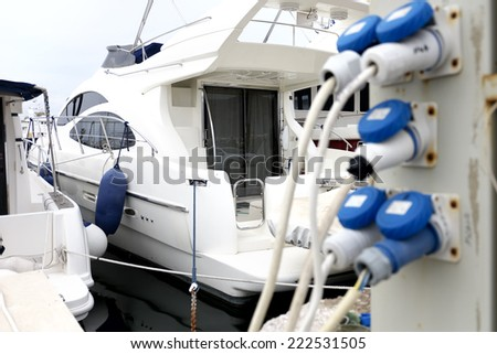 Electricity supply for yachts in a marina - stock photo