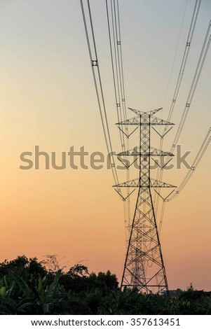Electricity tower and electric line, power line in red sky background