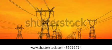 Electricity towers at orange sunset panoramic - stock photo