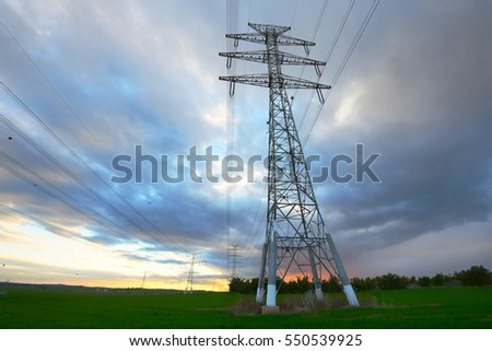 electricity towers at sunset time