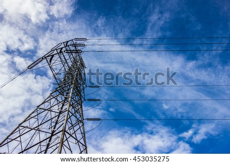 Electricity transmission pylon against blue sky. High voltage pylon - stock photo