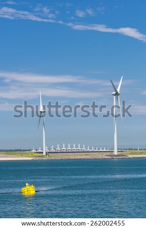 Electricity Windmills at the delta works in Zeeland, Netherlands - stock photo