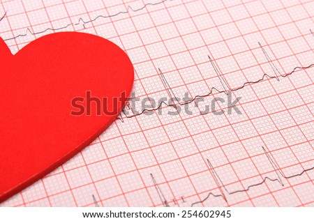 Electrocardiogram graph and heart shape, ekg heart rhythm, medicine concept - stock photo