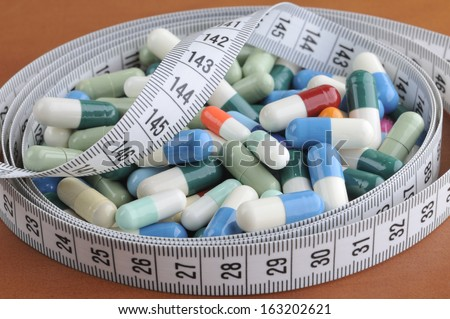 electrocardiogram with pills and tablets above, EKG medical health care and prevention - stock photo