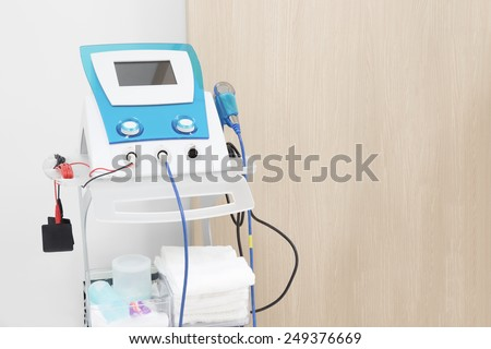 Electrodes electric massage medical equipment in physiotherapy room - stock photo