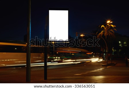 Electronic advertising board with empty screen copy space for your text message or promotion content, clear banner on the city at night, empty poster outdoors, public information billboard on roadway  - stock photo