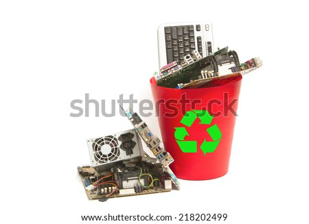 Electronic and computer parts trash in recycle bin  - stock photo