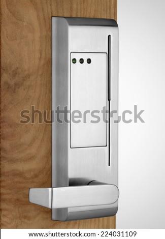 Electronic badge lock on wooden door - stock photo