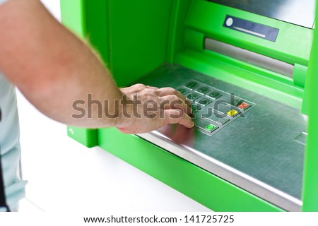 Electronic banking, credit card by ATM - stock photo