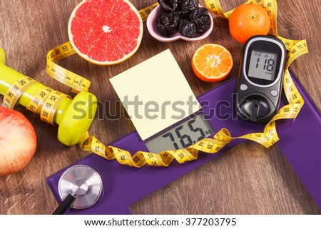 Electronic bathroom scale and glucose meter with result of measurement weight and sugar level, concept of healthy lifestyles, diabetes and slimming, sheet of paper for text - stock photo