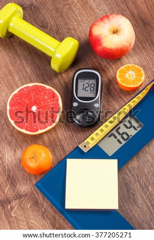 Electronic bathroom scale and glucose meter with result of measurement weight and sugar level, concept of healthy lifestyles, diabetes and slimming, copy space for text on sheet of paper - stock photo