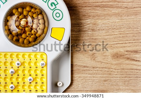 Electronic bingo game on wooden board. Horizontal image viewedfrom above. - stock photo