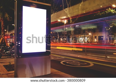 Electronic blank billboard with copy space for your text message or content, public information board in night city with blurred movement of cars on background, advertising mock up banner on roadside - stock photo