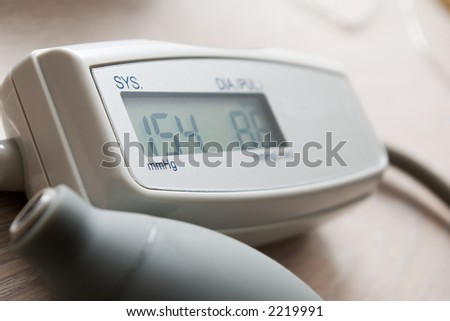 electronic blood pressure monitor - stock photo