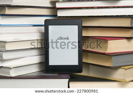 Electronic book shown versus several regular text books - stock photo