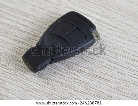 electronic car key on the wooden table, close up photo - stock photo