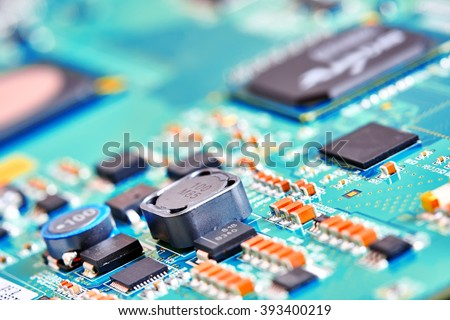 Electronic circuit board blured close up - stock photo