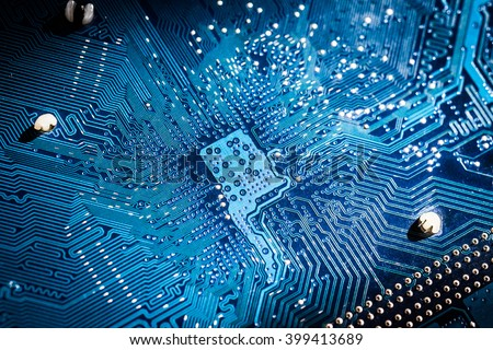 Electronic circuit board close up. blue PCB - stock photo