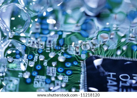 Electronic circuit board covered with water - stock photo