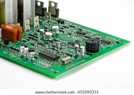 Electronic circuit board or PCB with IC, crystal, buzzer and other components. - stock photo