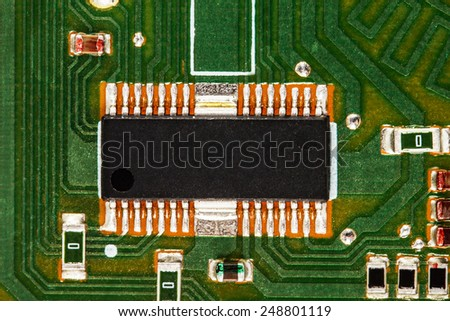 Electronic circuit board with chip and radio components - stock photo