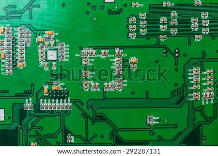 Electronic circuit board with processor. - stock photo