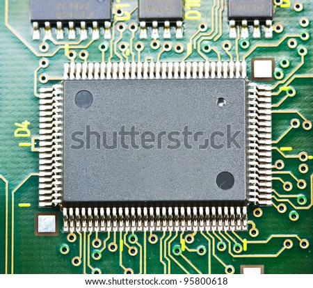 Electronic circuit chip on board - stock photo