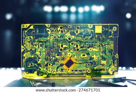 Electronic circuit transparent grunge and repair tools on dark background - stock photo