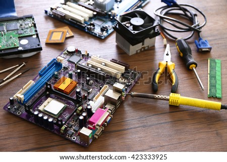 Electronic circuits on wooden background - stock photo