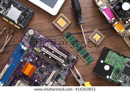 Electronic circuits on wooden table, top view - stock photo