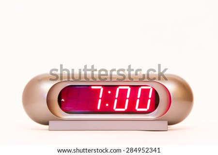 electronic clock alarm clock with red illumination and the time 7:00 - stock photo