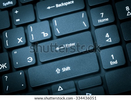 Electronic collection - close-up laptop keyboard with russian letter. The focus on the Enter key. Toning is blue. - stock photo
