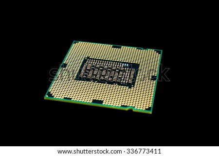 Electronic collection - Computer processor from the bottom side isolated on black background - stock photo