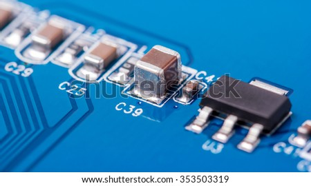 Electronic collection - fragment a computer PCB with SMD components - stock photo