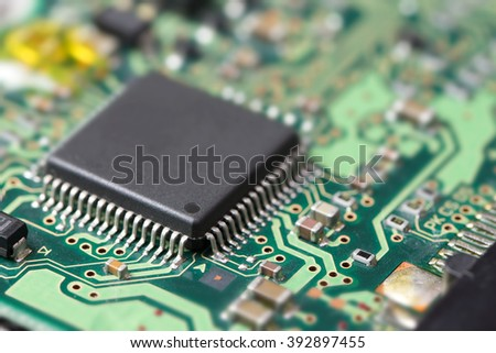 Electronic component on printed circuit board, shallow depth of field - stock photo