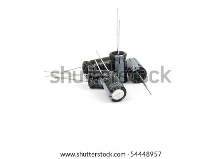 Electronic components ,five electrolytic capacitors isolated on white background - stock photo
