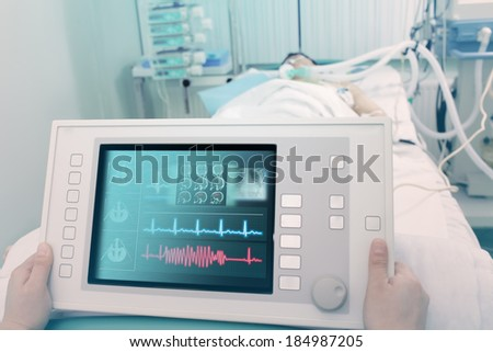 Electronic device for the treatment and diagnosis of the patient.  - stock photo