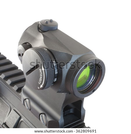 Electronic dot sight mounted on the rail of a modern sporting rifle - stock photo