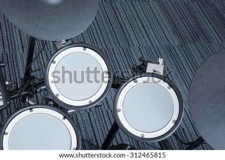 Electronic drum set as musical background technology theme, top view - stock photo