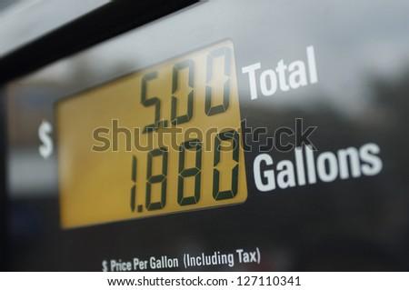 Electronic gas petrol pump displaying the petrol meter - stock photo
